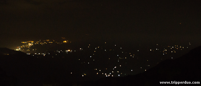 The lights of Sikkim on the opposite mountain. Try to locate the heart sign :)
